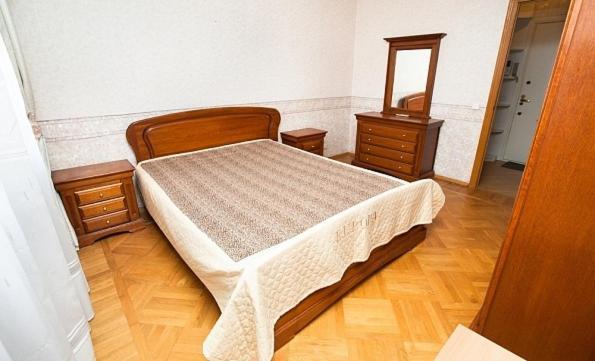 Кровать или кровати в номере Standard Brusnika Apartments Akademicheskaya