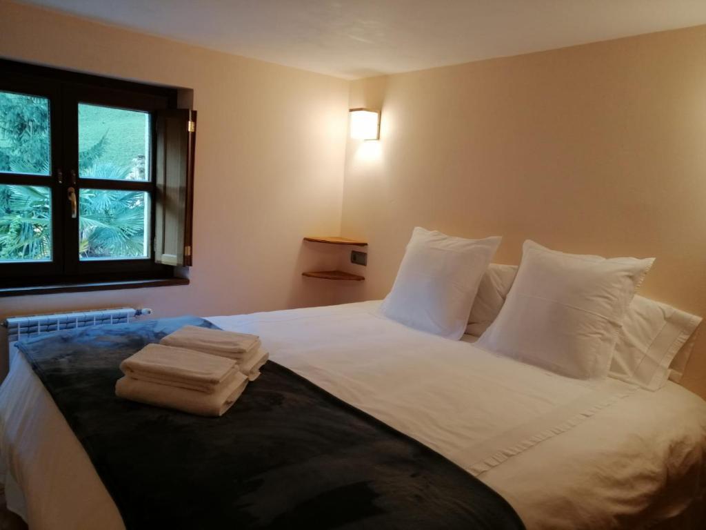Cama o camas de una habitación en El Caleyon
