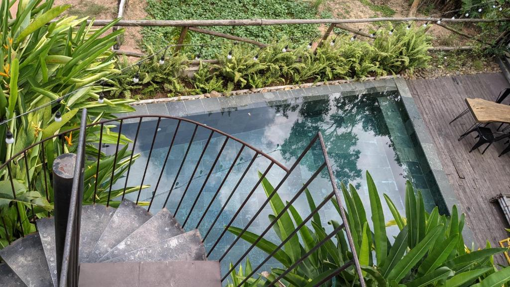 A view of the pool at NANO ECO-HOSTEL or nearby