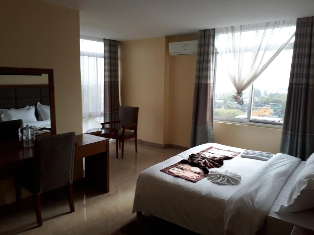A bed or beds in a room at Imperial Hotel & Apartments