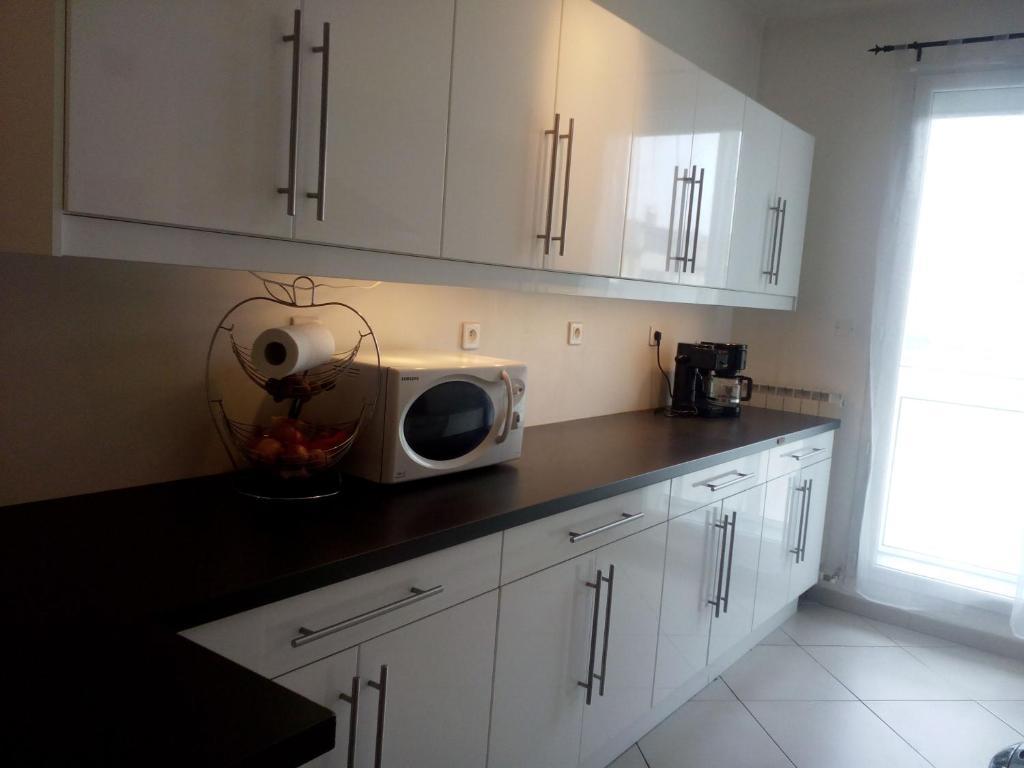 A kitchen or kitchenette at Très joli appartement T3 atypique