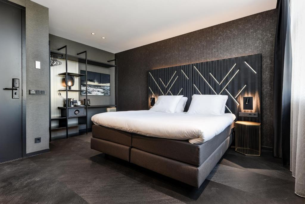 A bed or beds in a room at Le Marin Boutique Hotel