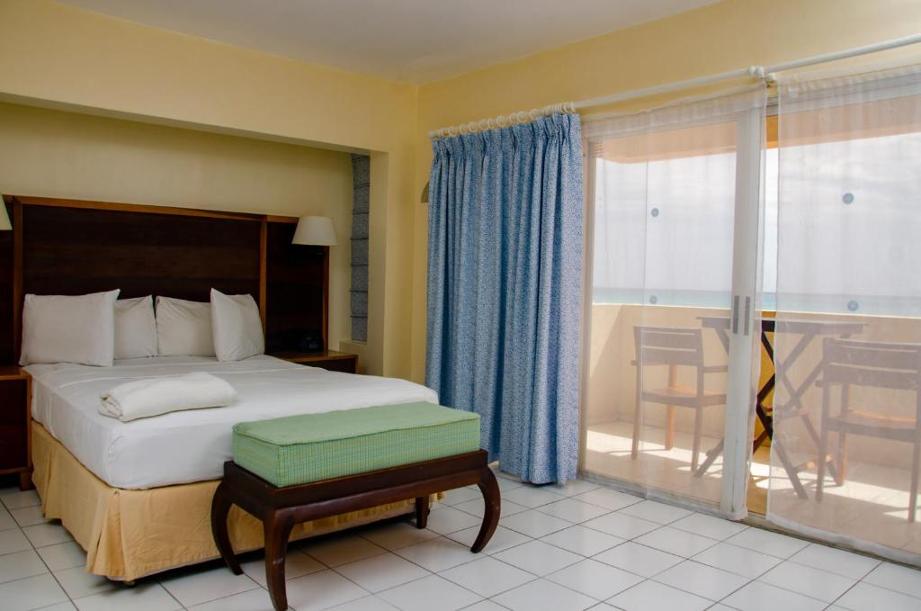 A bed or beds in a room at Infinity on the Beach