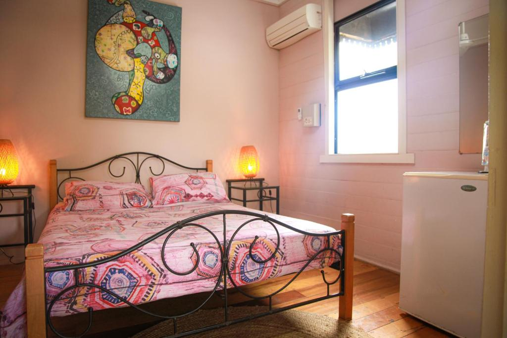 A bed or beds in a room at Dreamtime Travellers Rest , Guest House