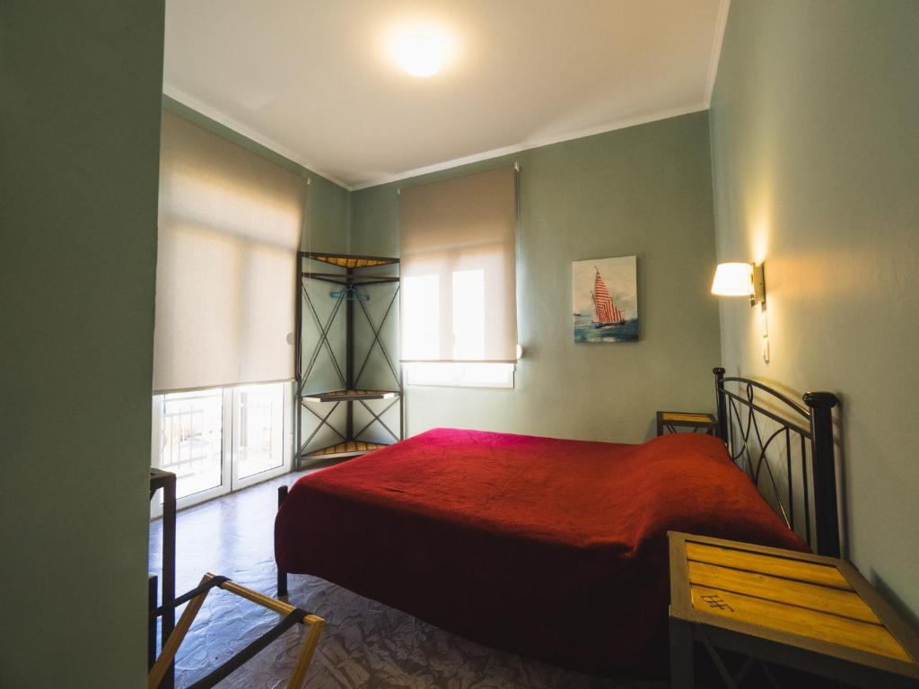 A bed or beds in a room at Filoxenia Hotel