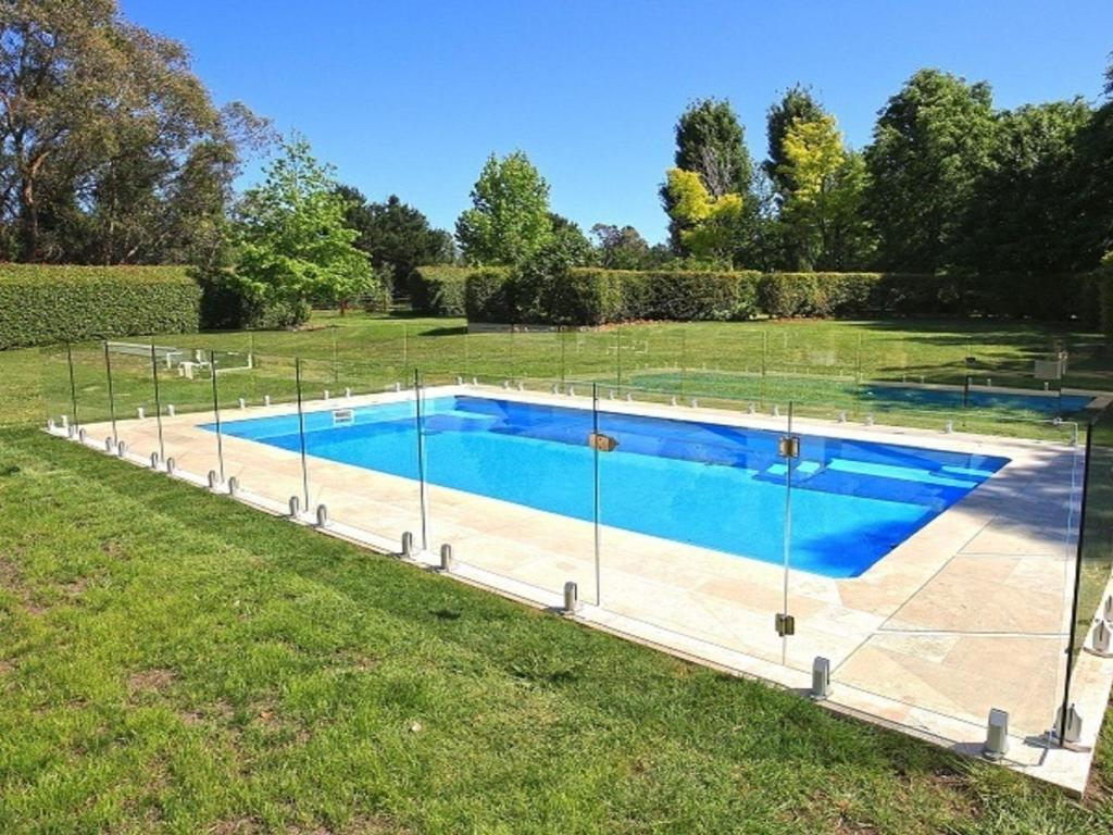 The swimming pool at or near Sarnia - period home in garden oasis with pool