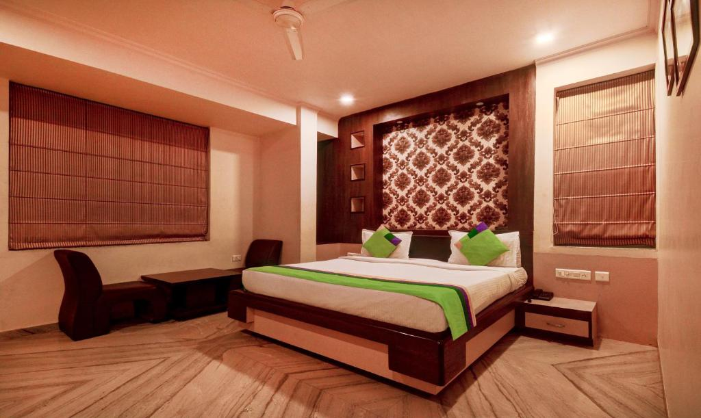 A bed or beds in a room at Treebo Trend The Prime Jaipur