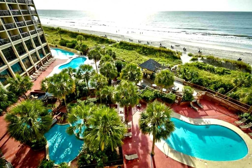 A view of the pool at Beachfront Resort Condo with Lazy River and Pools or nearby