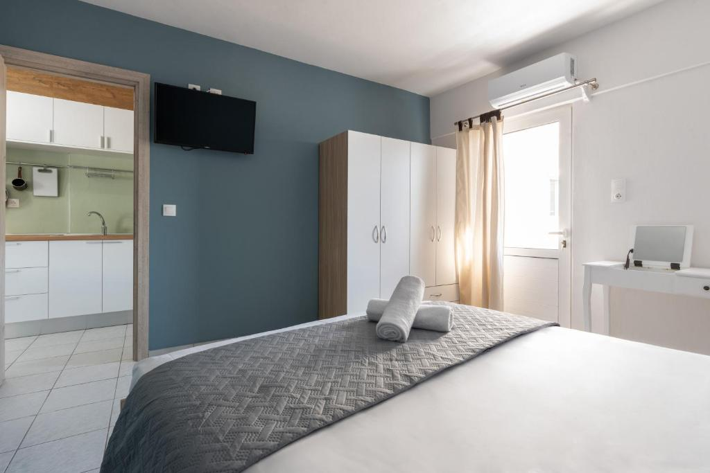 A bed or beds in a room at antéste Ierapetra sea & city