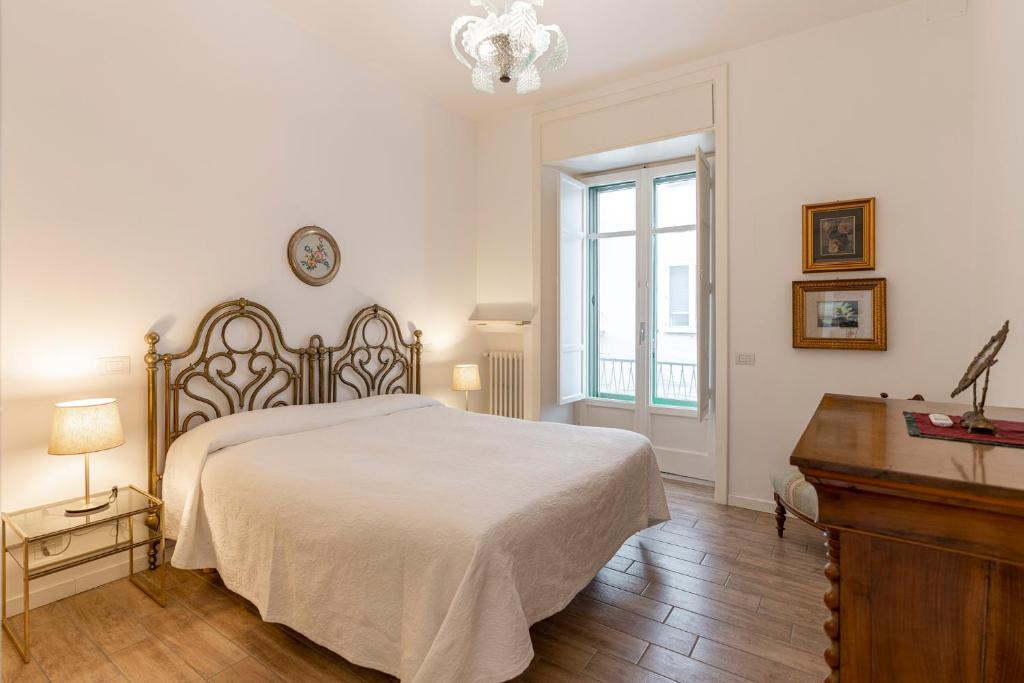 A bed or beds in a room at Starhost - CASA GUGLIELMO