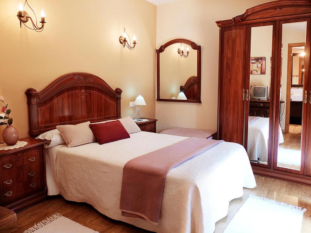 Cama o camas de una habitación en Casa Rural Marga