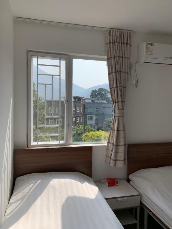 Letto o letti in una camera di City Oasis Guesthouse