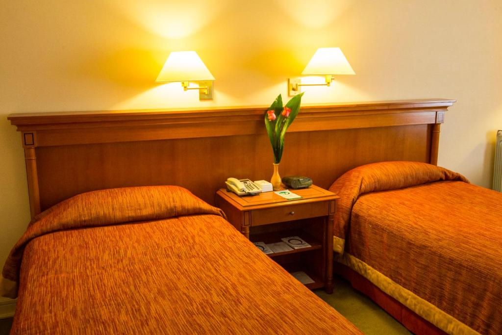 Кровать или кровати в номере Austral Plaza Hotel