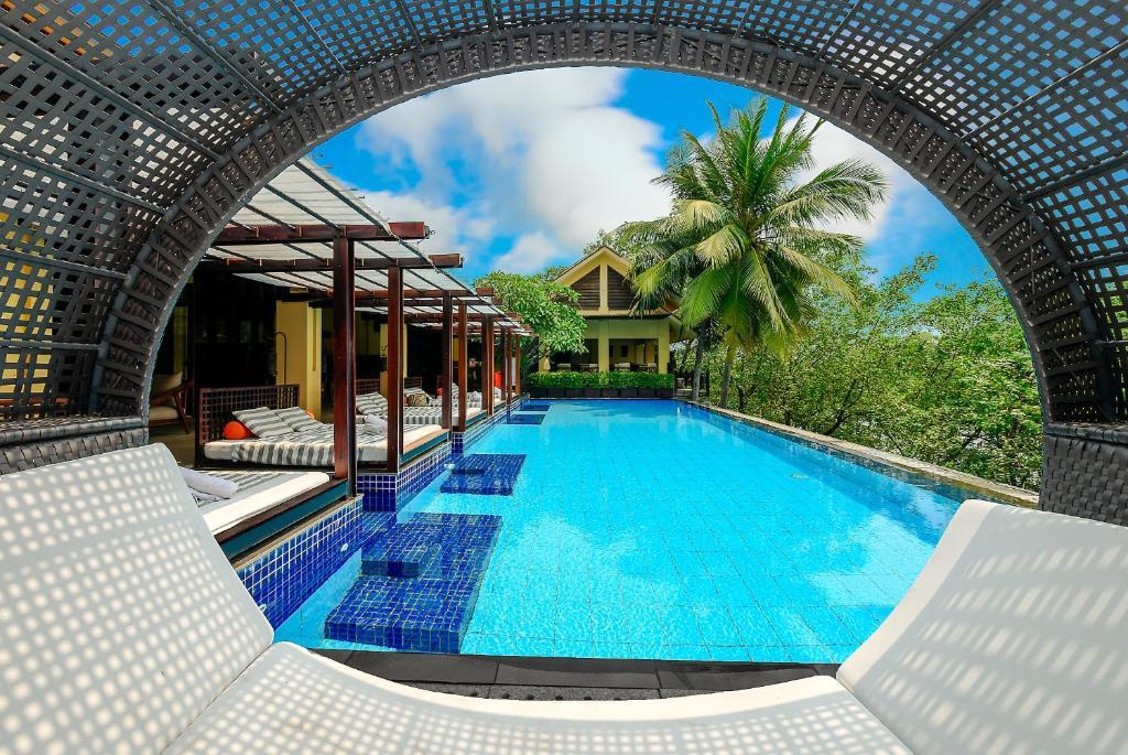 The swimming pool at or close to Abogo Resort Villa Green Island Da Nang