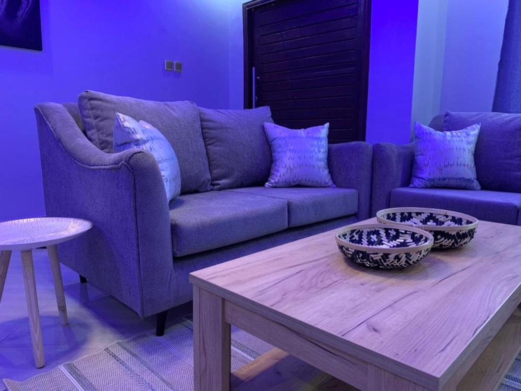 A seating area at ZOWE LUXURIOUS APARTMENTs