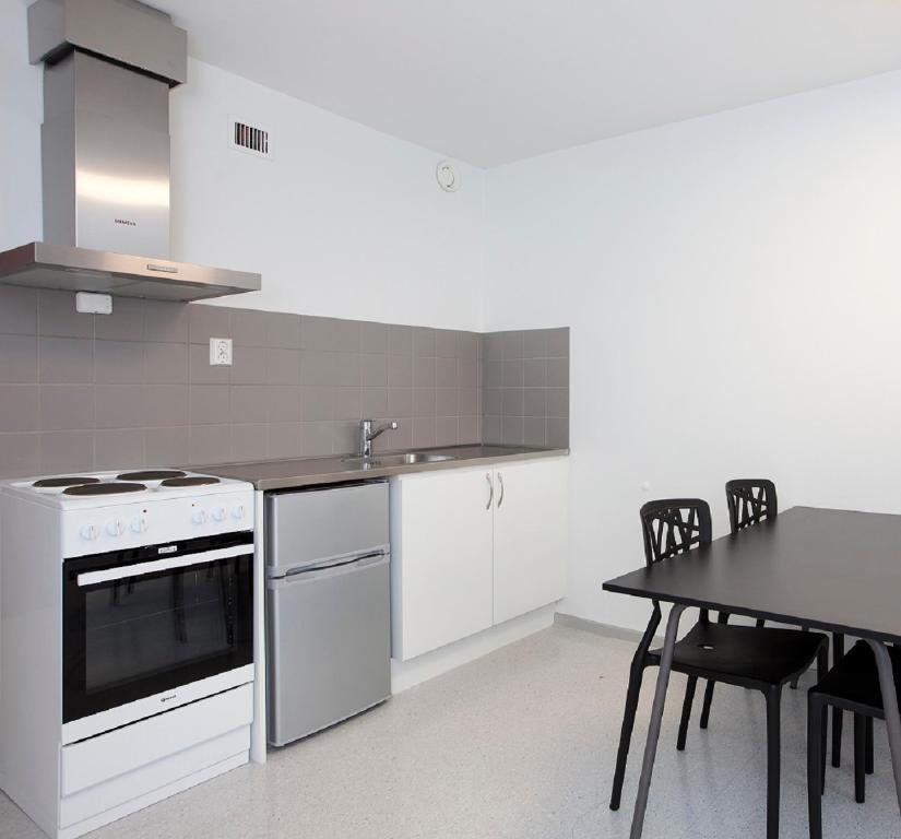 A kitchen or kitchenette at Anker Apartment – Sentrum