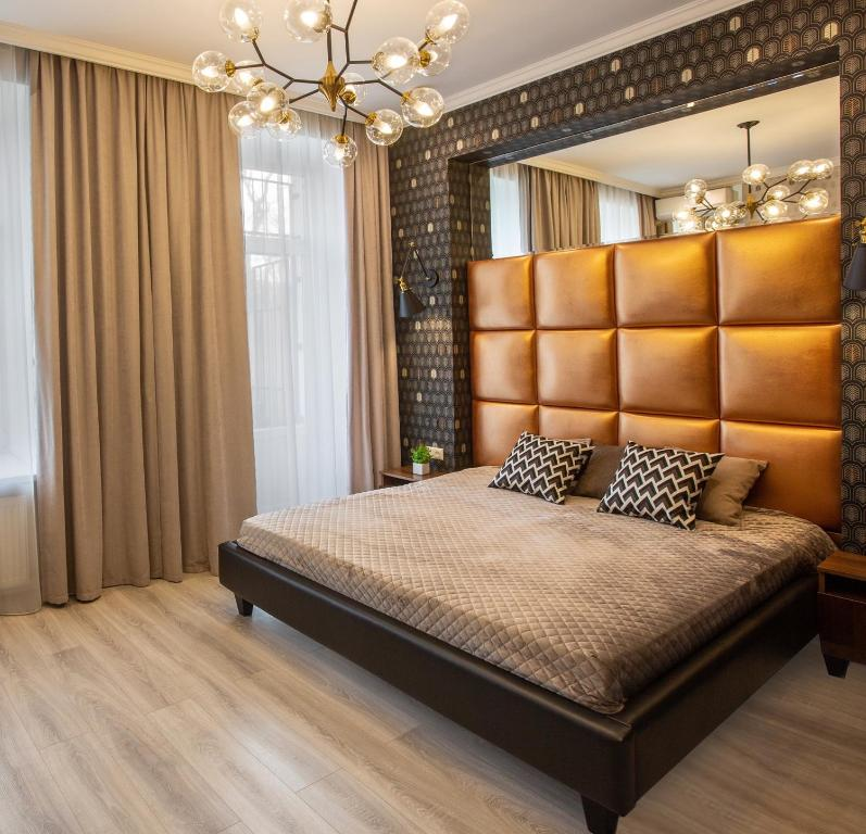 A bed or beds in a room at City Garden Apartments
