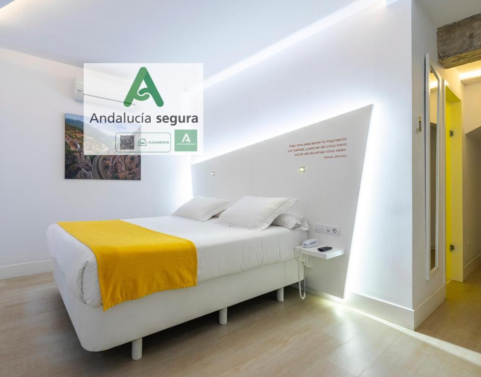 Letto o letti in una camera di Atarazanas Málaga Boutique Hotel