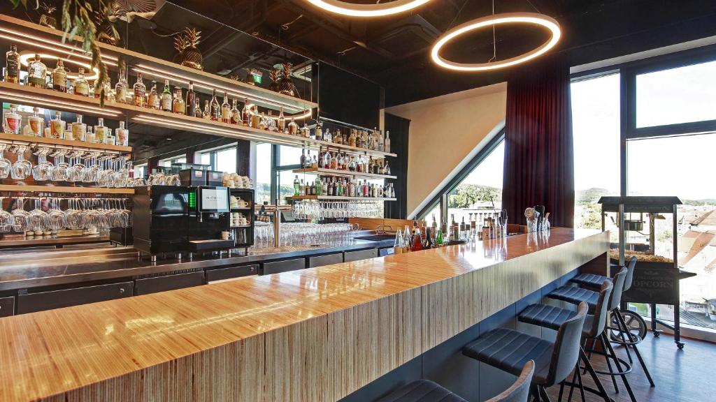 The lounge or bar area at Hotel am Remspark