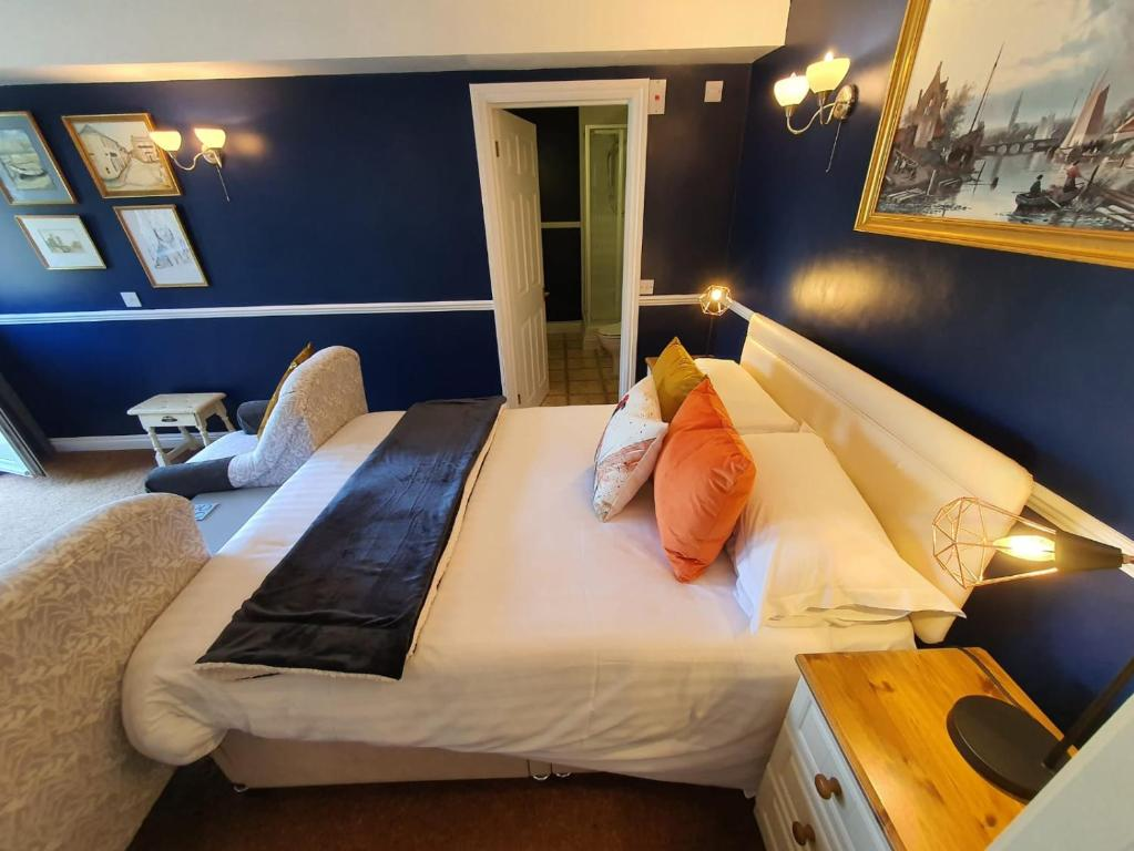 A bed or beds in a room at The Snooty Fox