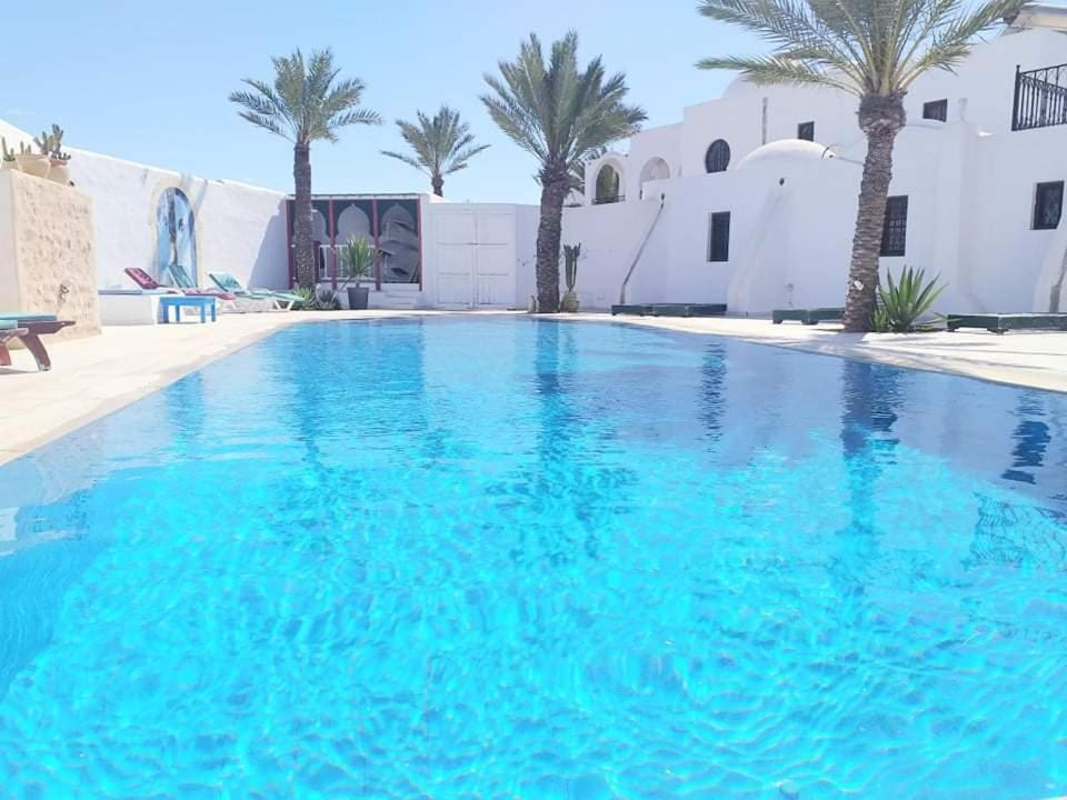 The swimming pool at or near Maison Leila