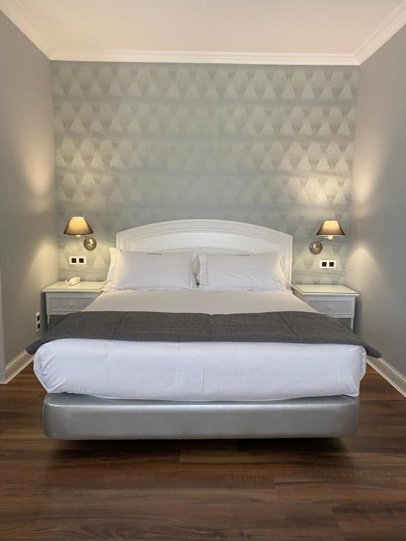 Cama o camas de una habitación en Las Rocas Playa Hotel