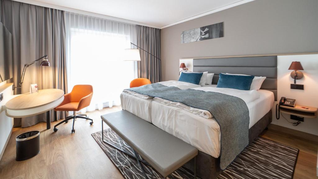 A bed or beds in a room at Holiday Inn Berlin Airport - Conference Centre, an IHG Hotel