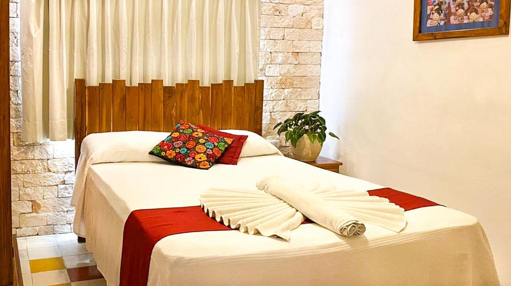 Un ou plusieurs lits dans un hébergement de l'établissement Hotel Casa Hipil