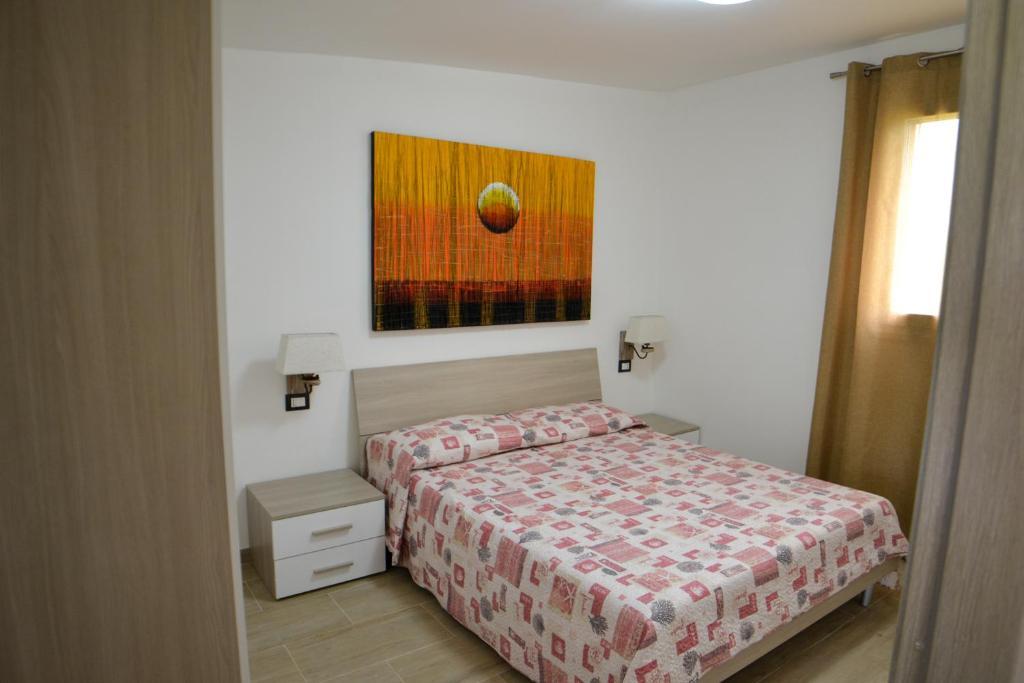 Letto o letti in una camera di Villa Gladyr