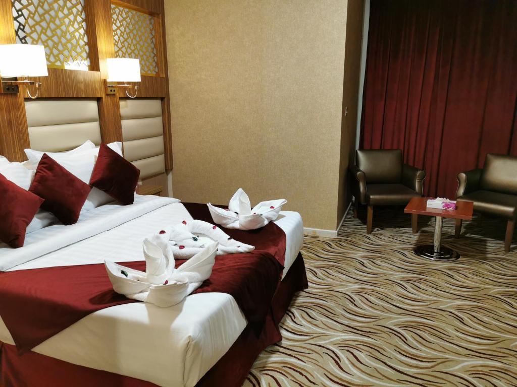 Cama ou camas em um quarto em Hayatt International1
