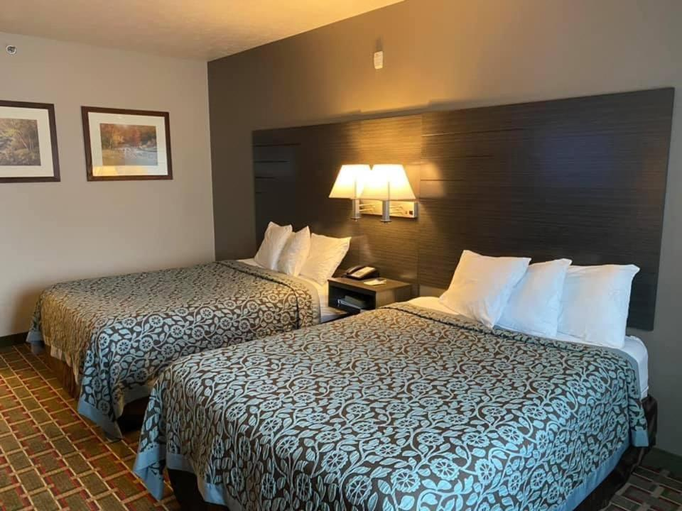 A bed or beds in a room at Days Inn by Wyndham Pentwater