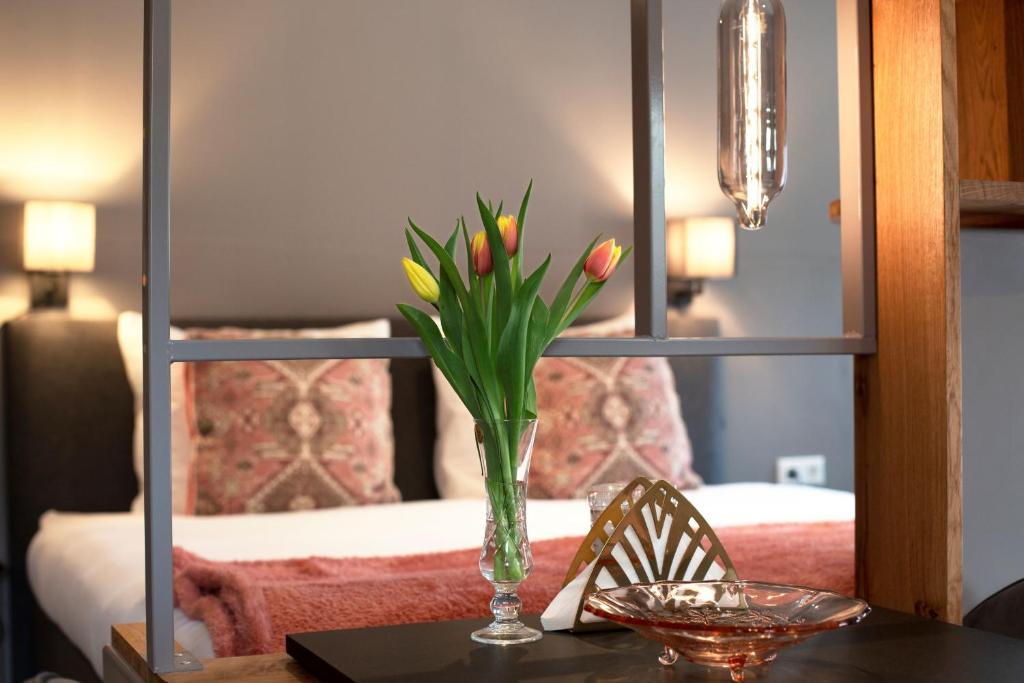 Een bed of bedden in een kamer bij Adelaerthoeve Logies & Ontbijt
