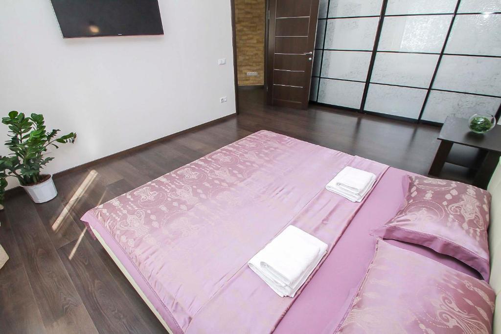 Кровать или кровати в номере Апартаменты на КАРОЛИНСКОГО