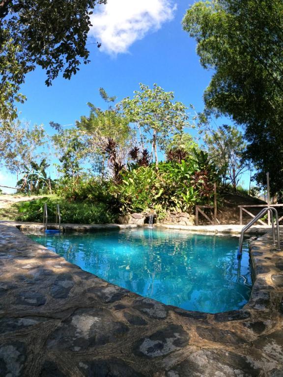 The swimming pool at or near Colores de la Sierra