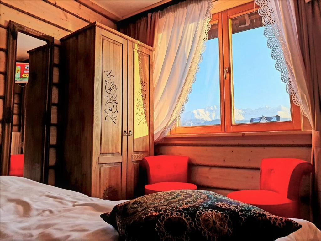 Łóżko lub łóżka w pokoju w obiekcie Willa Karpatia Ski&SPA