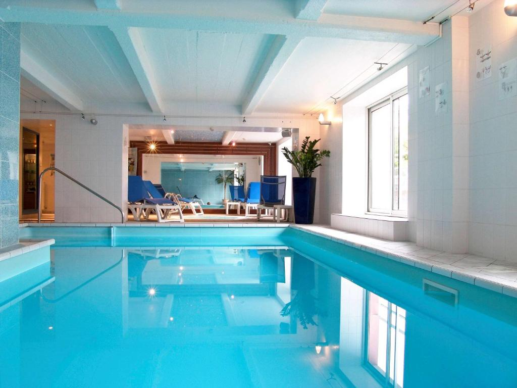 The swimming pool at or near Mercure Epinal Centre