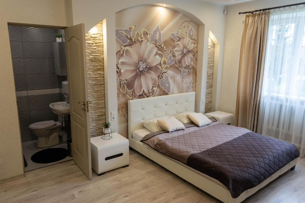 A bed or beds in a room at Lauvas Līcis