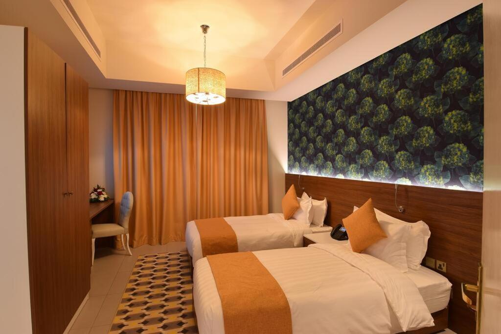 Cama ou camas em um quarto em FLAMINGO Boutique Hotel