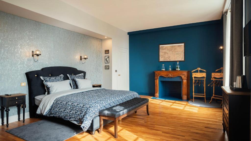 Un ou plusieurs lits dans un hébergement de l'établissement Les Chambres du Champagne Collery