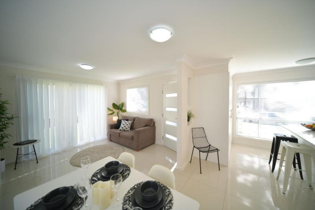 A seating area at Craig's Place, 2br Short Term Accommodation - Western Sydney Area