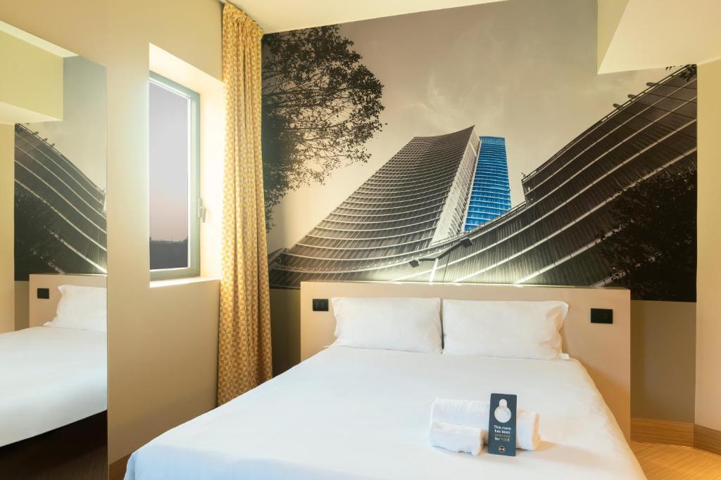 Ένα ή περισσότερα κρεβάτια σε δωμάτιο στο B&B Hotel Milano San Siro
