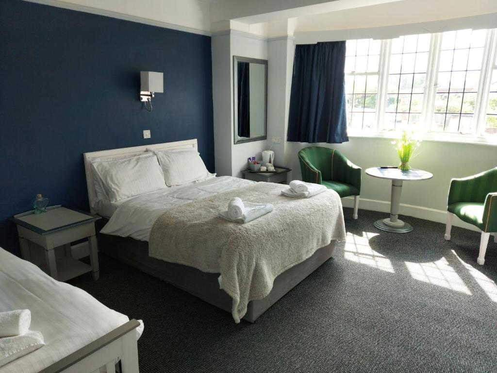 A bed or beds in a room at The Washford Inn