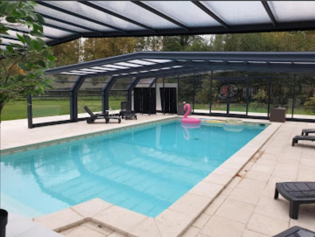 The swimming pool at or near Château De Breuil