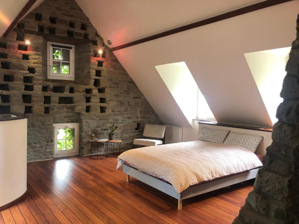 Un ou plusieurs lits dans un hébergement de l'établissement Suite 50m2 - Le Clos des Fontaines