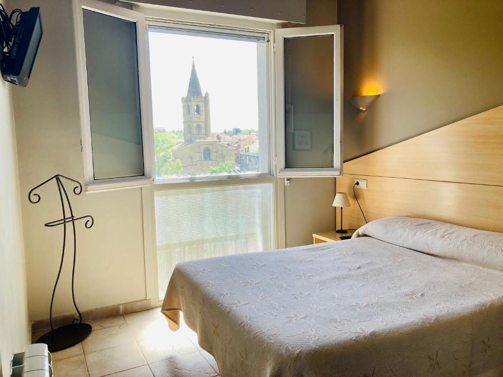Cama o camas de una habitación en Hostal Rural J.P.