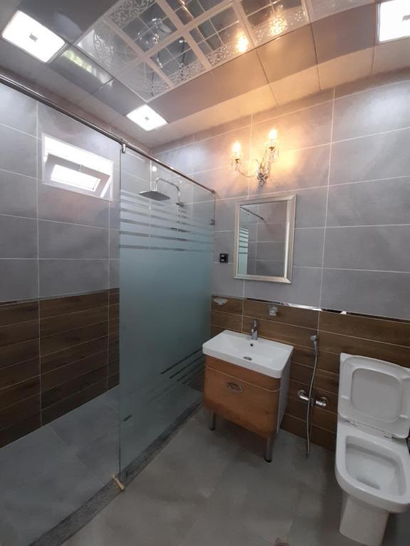 Um banheiro em Raffles Garden Villa