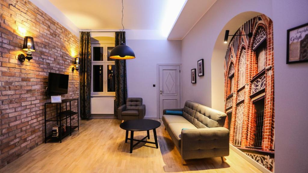 A seating area at Apartamenty Szeroka 23