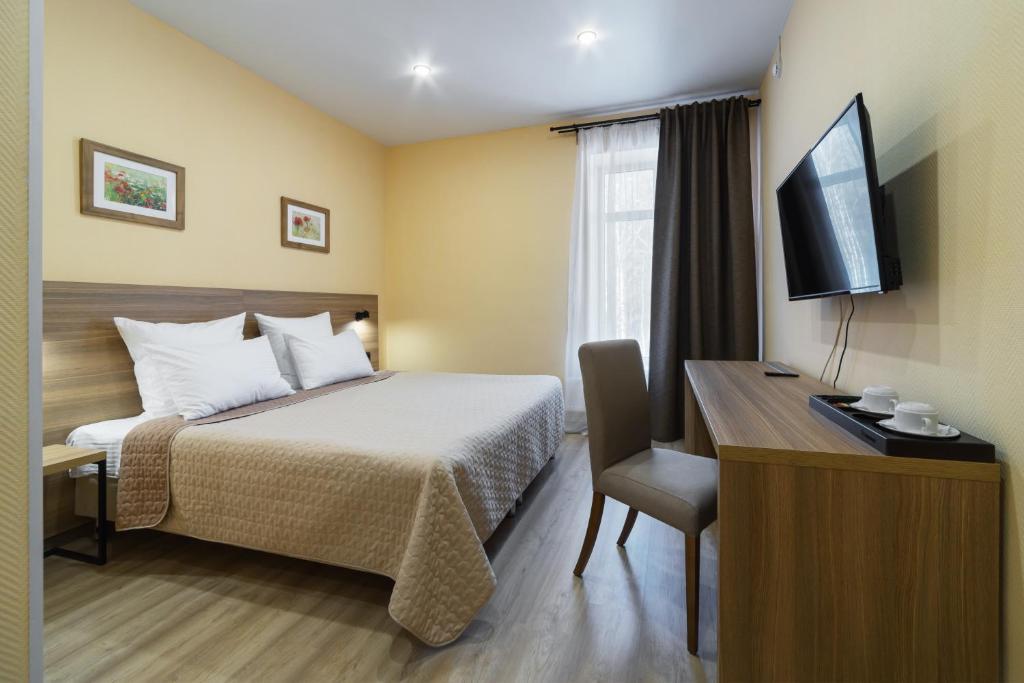Кровать или кровати в номере AVS Отель