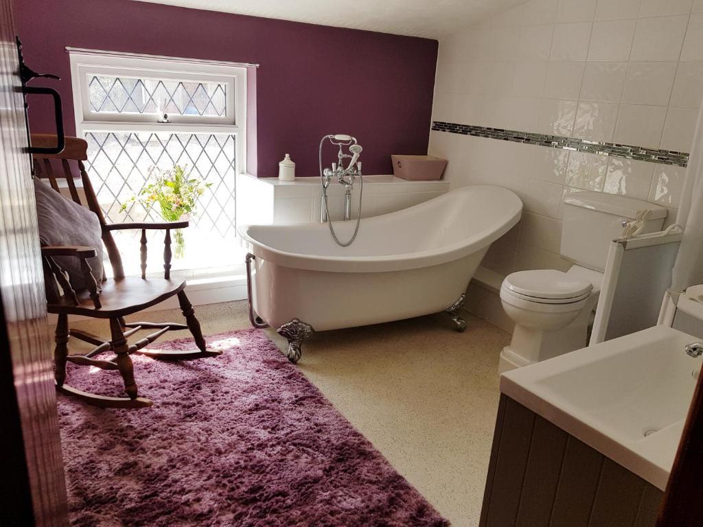 "A bathroom at Brynheulog""Sunshine Hill"" Country Cottage, Craig Cefn Parc, SA6 5RH"