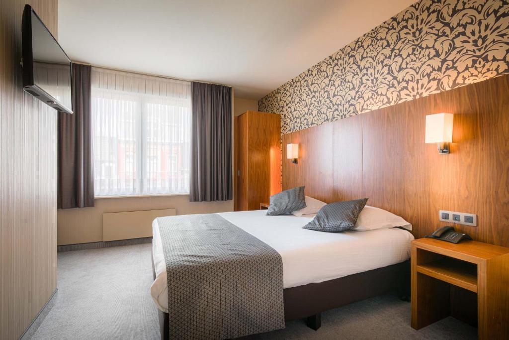 Een bed of bedden in een kamer bij Hotel Chamade